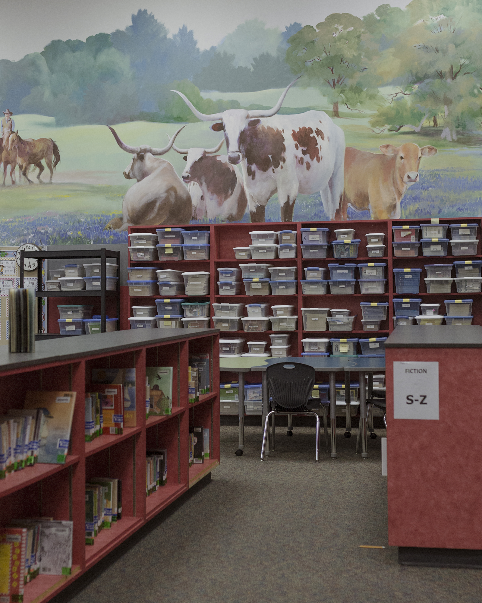 A mural hangs above the bookshelves of my childhood elementary school, depicting the landscape of what Fulshear once was.