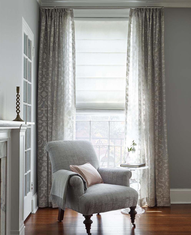 Back slat roman shade with pleated drapes