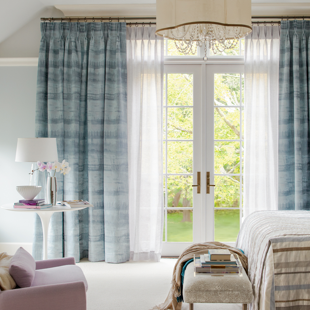 Pleated drapes over sheers
