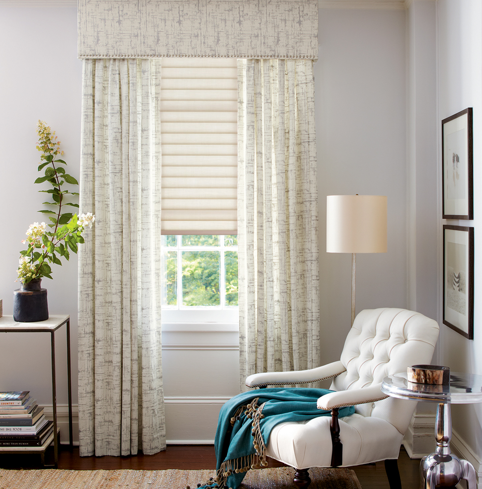 Straight cornice over pleated drapes and Hunter Douglas Sonnette® Cellular Roller Shades