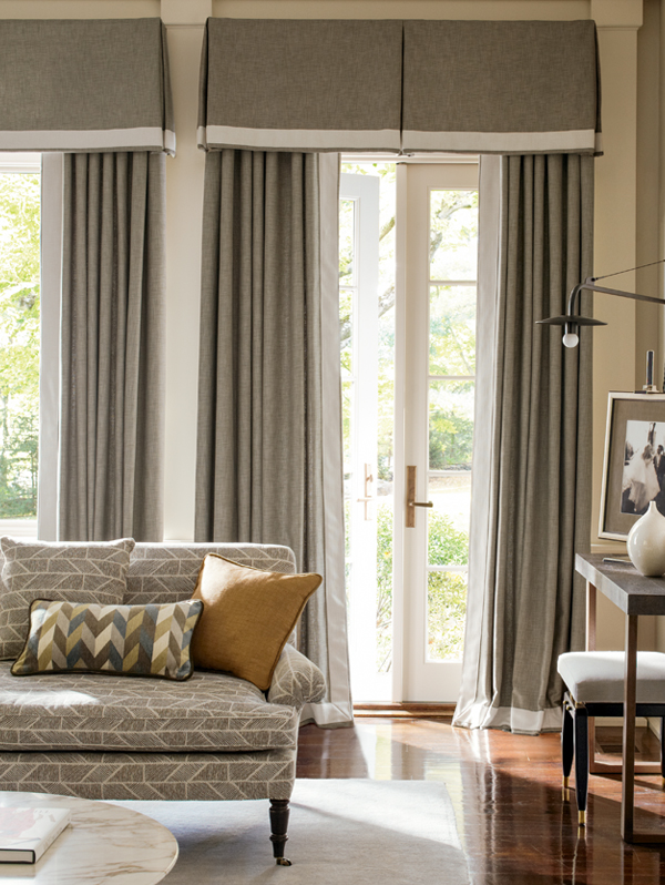 Inverted box pleated valance over pleated drapes