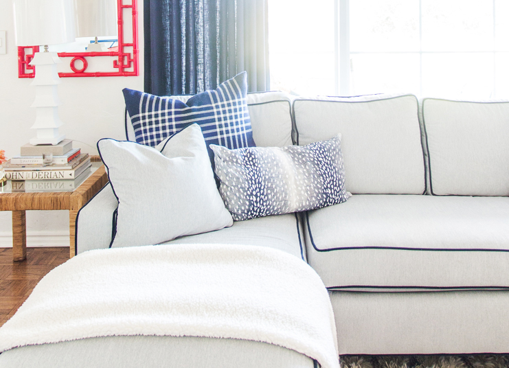 Pencil Shavings Studio   customized the     Classic Home   sectional in   Crypton   Synergy performance fabrics in Haze with a contrast welt in Crypton Forever Velvet in Navy Blazer.