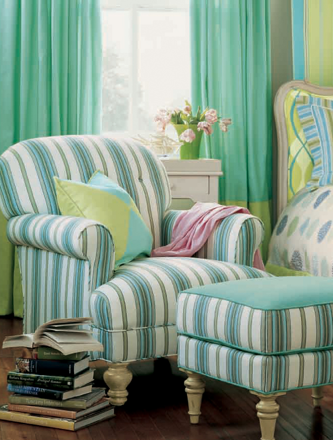 A reupholstered chair and ottoman in a bright stripe create the perfect reading spot.