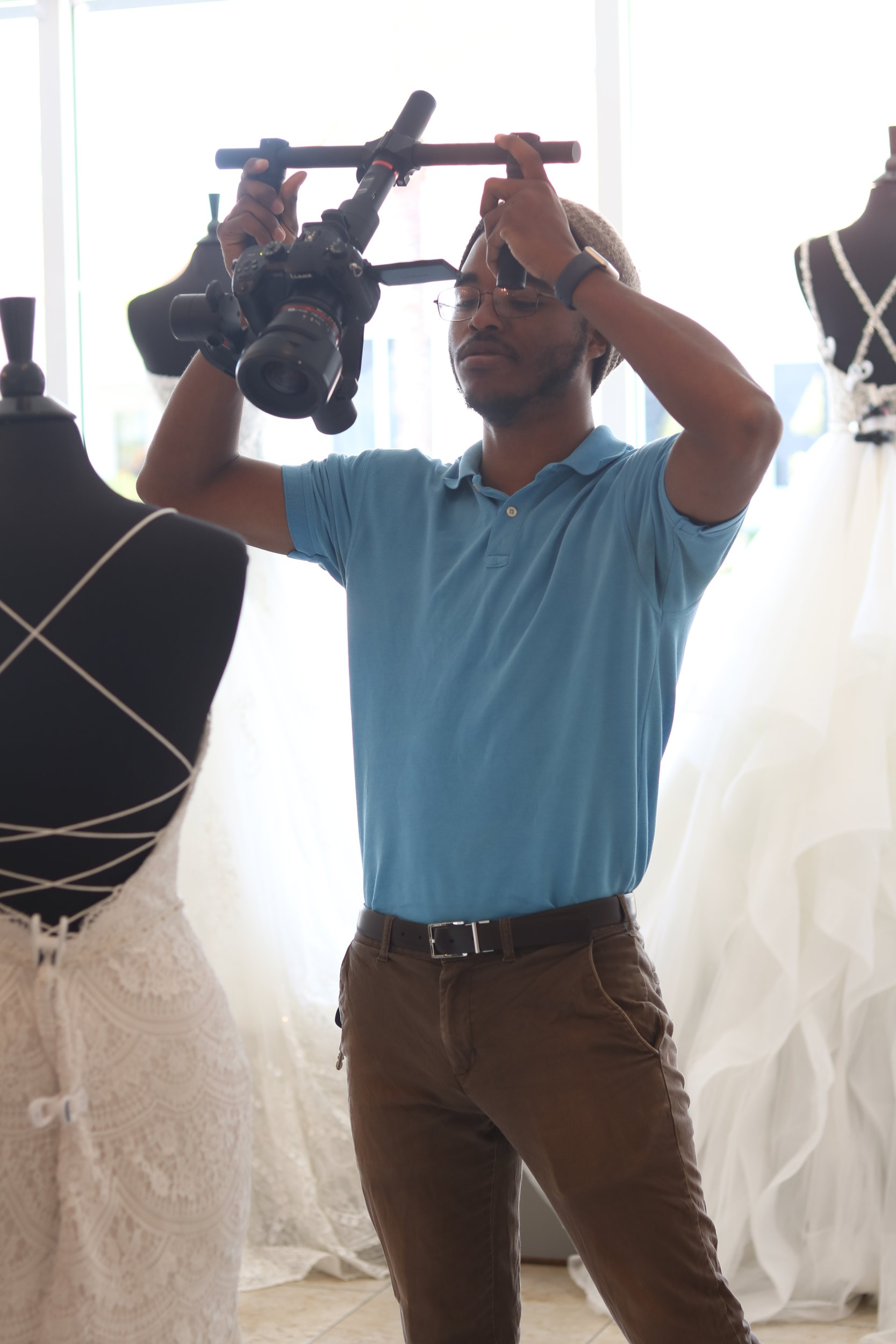 Terrence shooting a bridal shop promotional video. Photo by Josue Jeune.