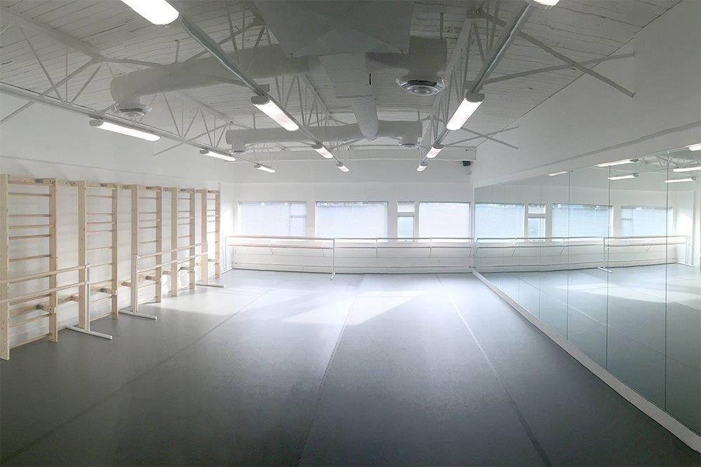 "DIAGHILEV STUDIO - We are growing! We are thrilled to announce that our Diaghilev Studio is currently under construction and will provide dancers with an additional 1050 SF of top-of-the-line studio space by the start of our upcoming 2016|2017 academic year! Diaghilev Studio will boast the same exposed high ceilings, expansive natural light, air-conditioning, 8 foot mirrors, and of course, exceptional floating maple Harlequin sprung floors, Harlequin ""Cascade"" marley flooring, Harlequin maple hardwood barres, and custom-made barre mounts designed and built especially with our dancers in mind."