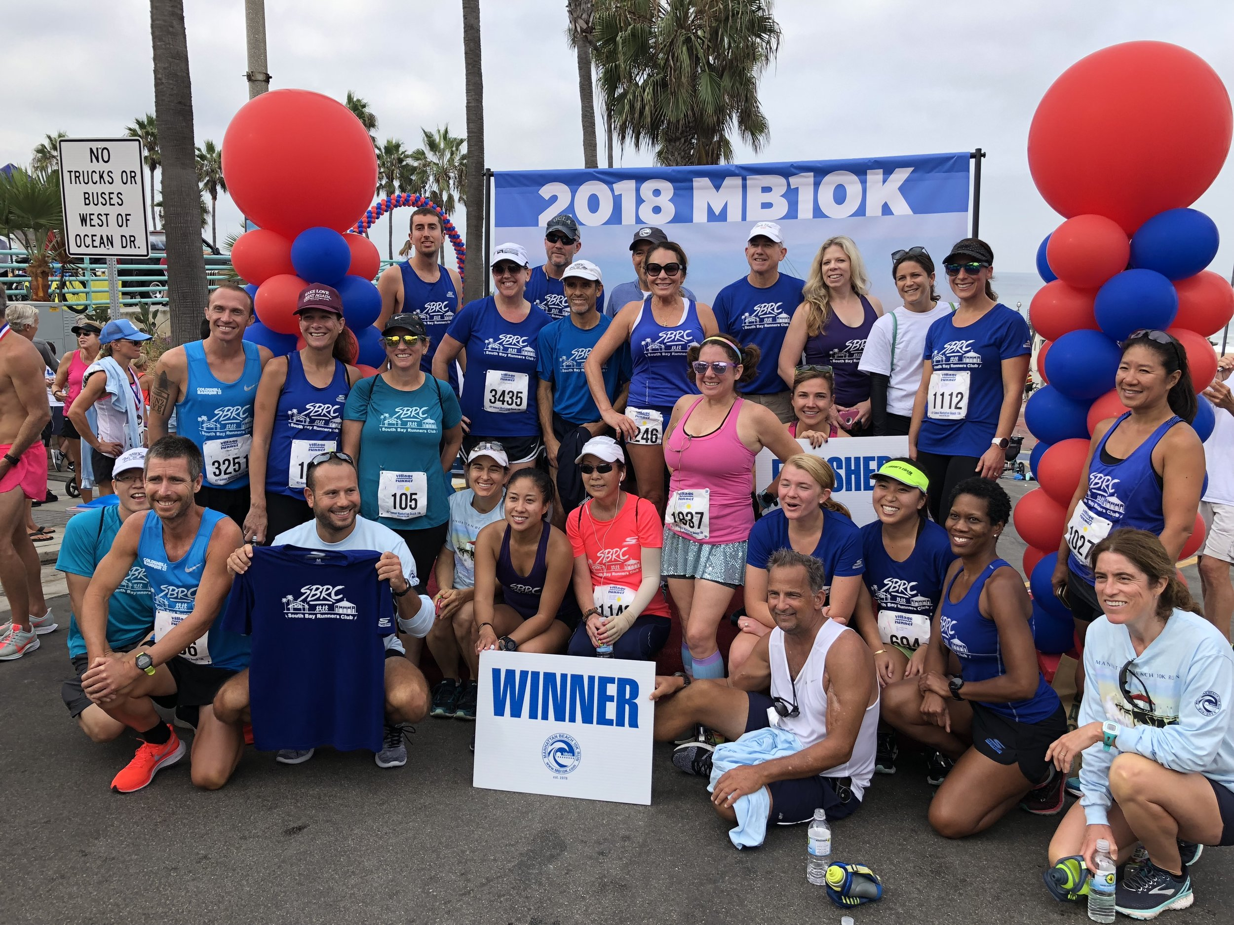 South Bay Runners Club members at 2018 Manhattan Beach 10k Awards podium.
