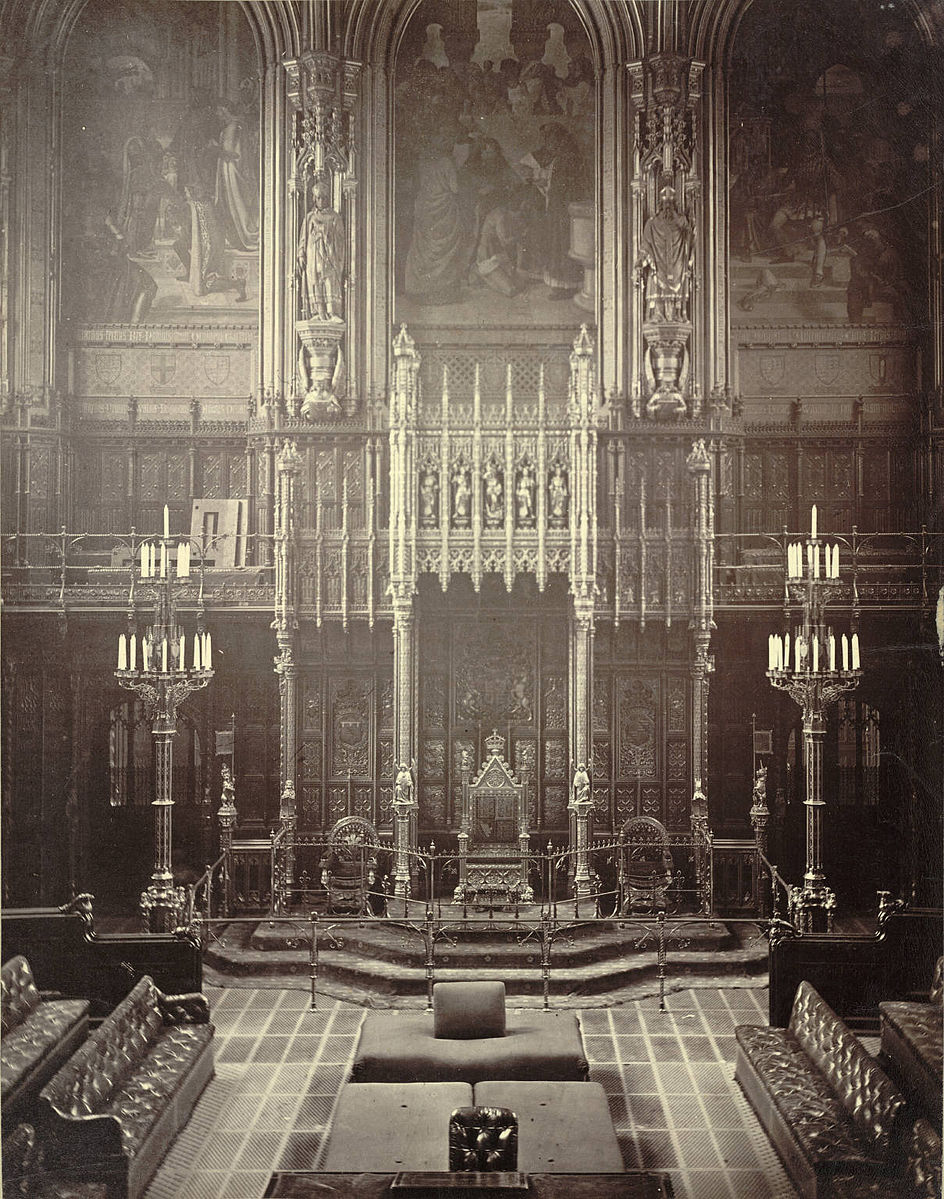 House of Lords, Westminster, c.1870-1885. The Woolsack (with back-rest) can be seen facing the throne in the upper foreground   Author: unknown
