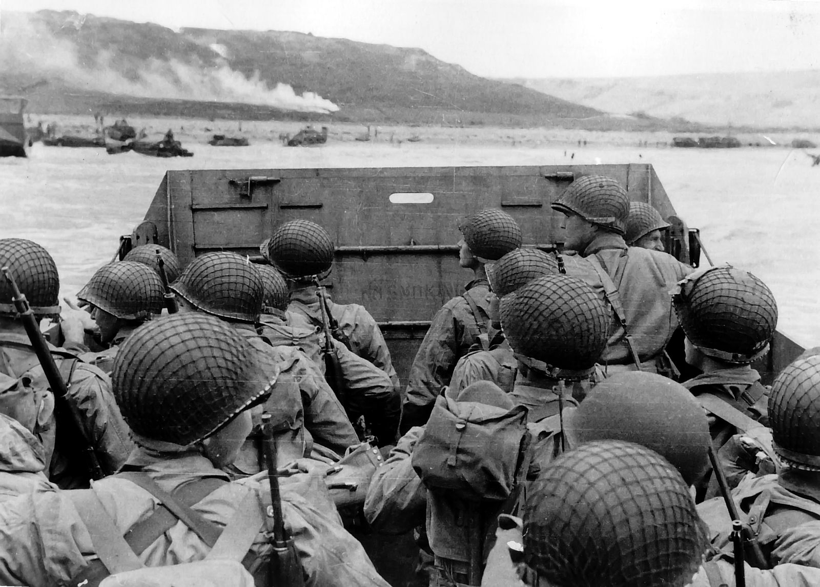 """Troops in an LCVP landing craft approaching """"Omaha"""" Beach on """"D-Day"""", 6 June 1944. Photograph from the Army Signal Corps Collection in the U.S. National Archives.  The original uploader was  Taak at English Wikipedia."""
