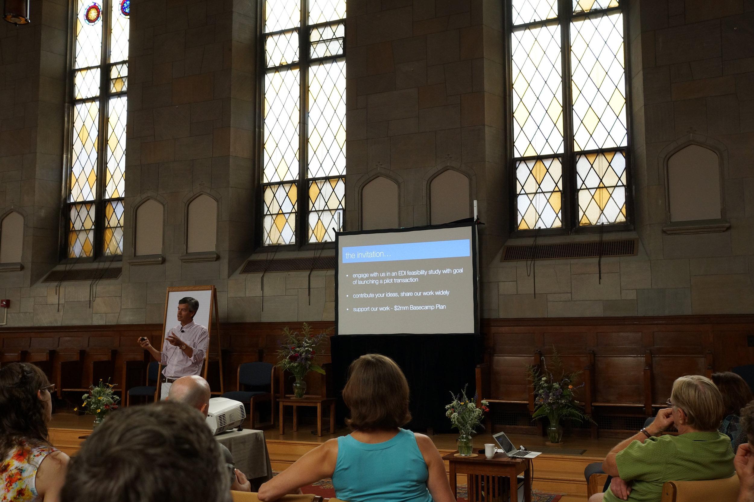 John Fullerton giving a presentation