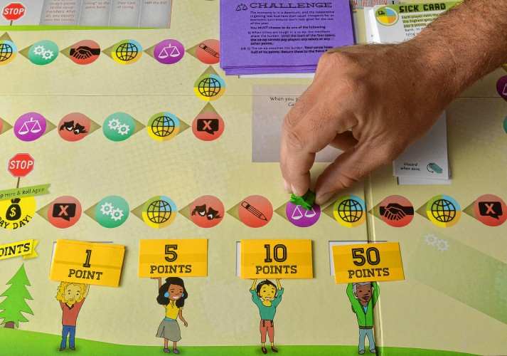 Detail of the board game, Co-opoly, made by Toolbox for Education and Social Action.  Source: Daily Hampshire GAZETTE STAFF/JERREY ROBERTS
