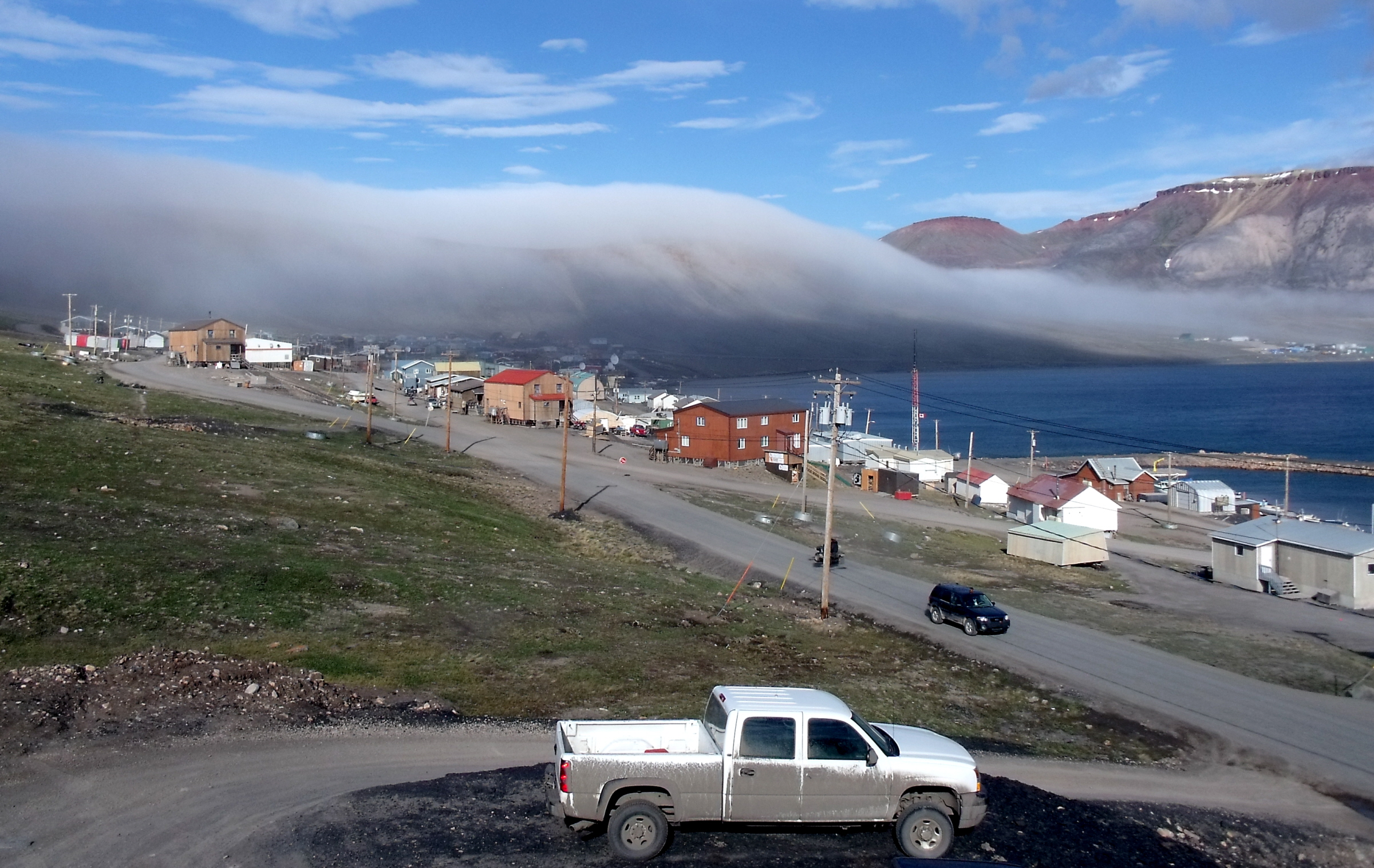 The fog rolling over hills in Nunavut By  Mike Beauregard