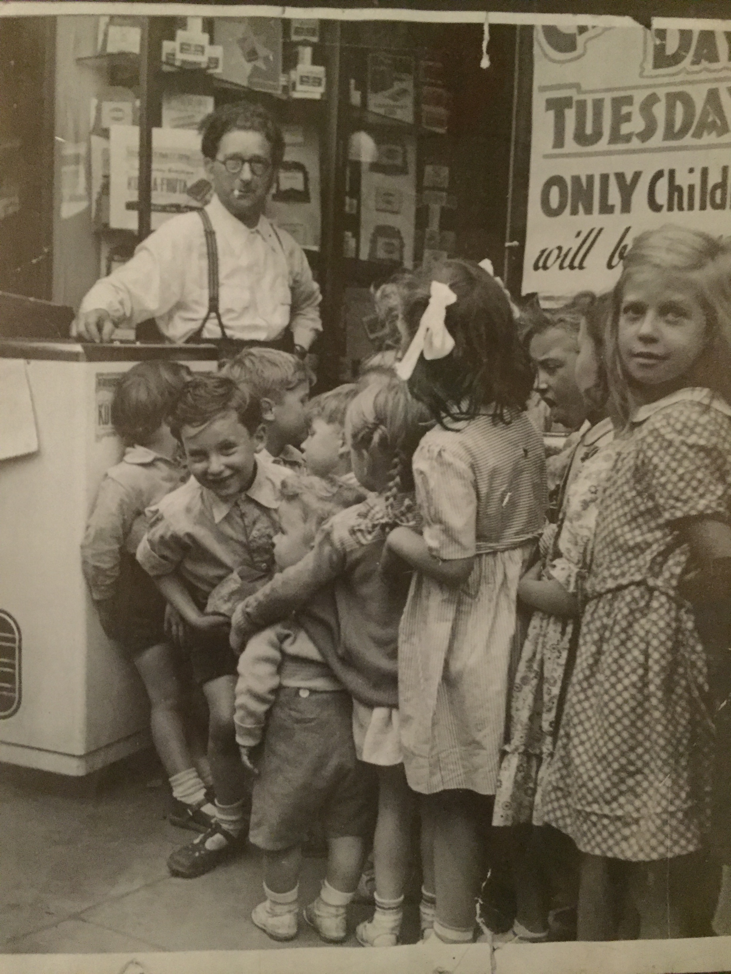 Colin Greer, left front,with his father at the family candy store