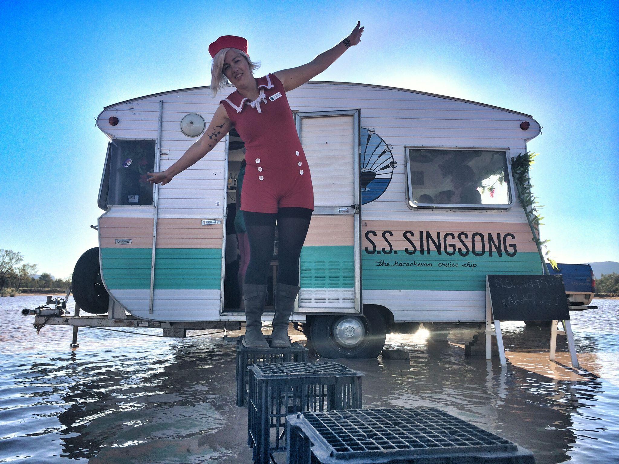 Alex Kelly in front of traveling Karaoke trailer