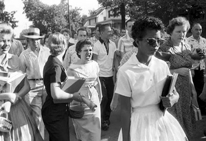 "September 4, 1957, Elizabeth Eckford -- one of nine black students attempting to attend Central High School, in Little Rock, Arkansas -- is met with jeers. The Arkansas governor, defying a federal order, has National Guard troops stop the black students. Eventually, the U.S. Army, dispatched to Little Rock by President Eisenhower, safeguarded the entry of the ""Little Rock Nine.""  by  The U.S. Embassy The Hague"