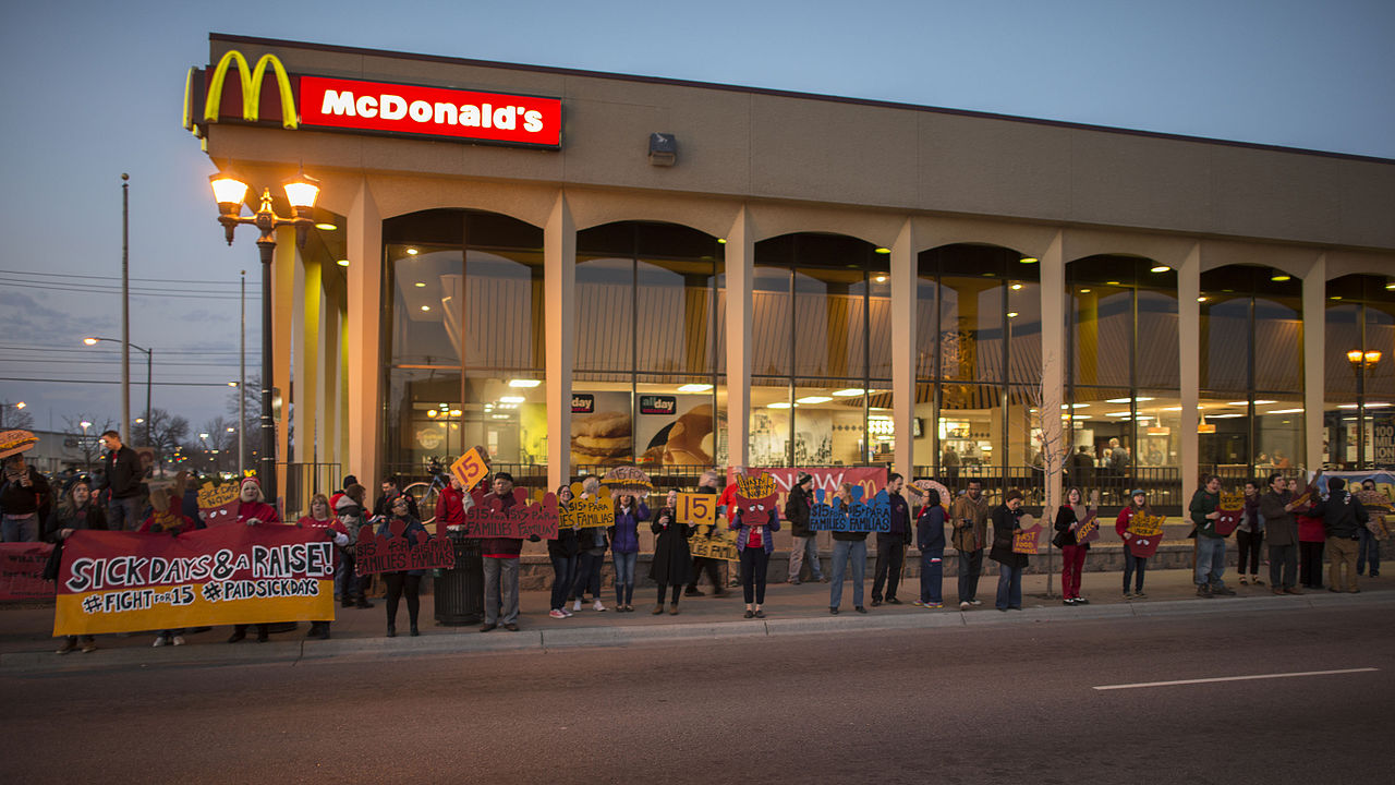 Fast food workers on strike for higher minimum wage and better benefits.    Source