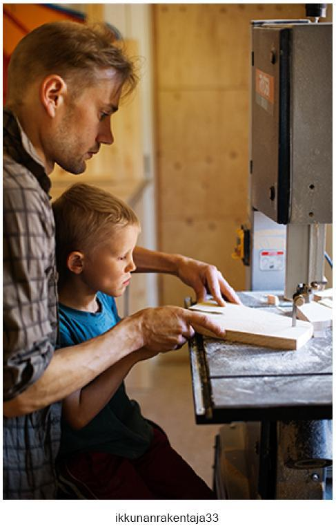 Juha working with his son