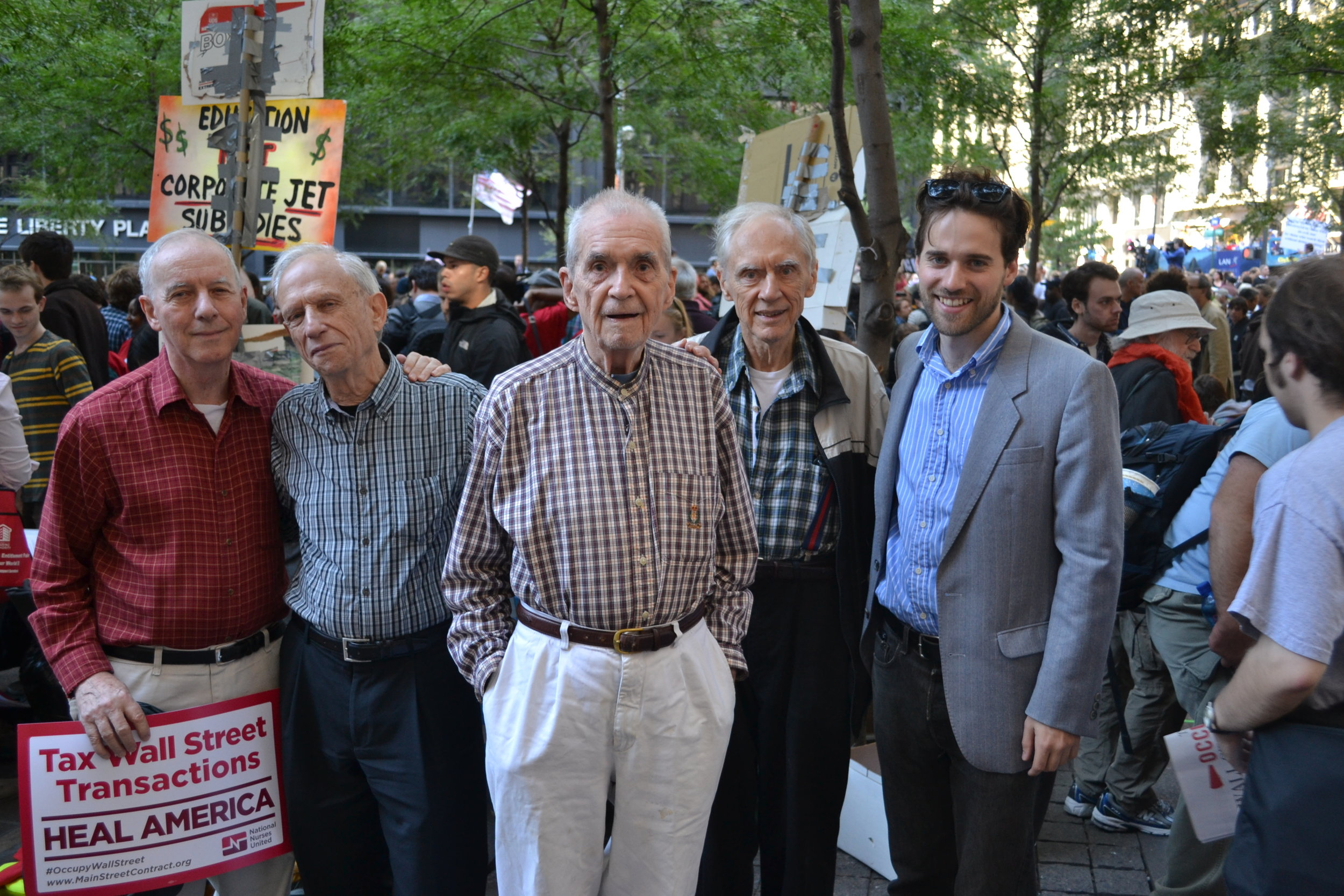Nathan (right) with activist priests during Occupy Wall Street