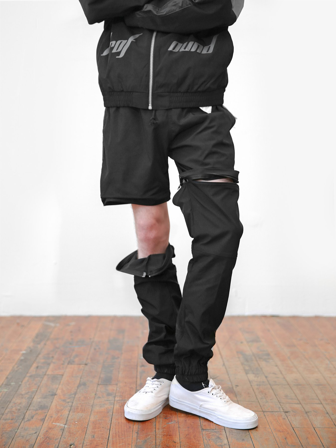 Detachable Windbreaker Track Pants by Profound Aesthetic $110