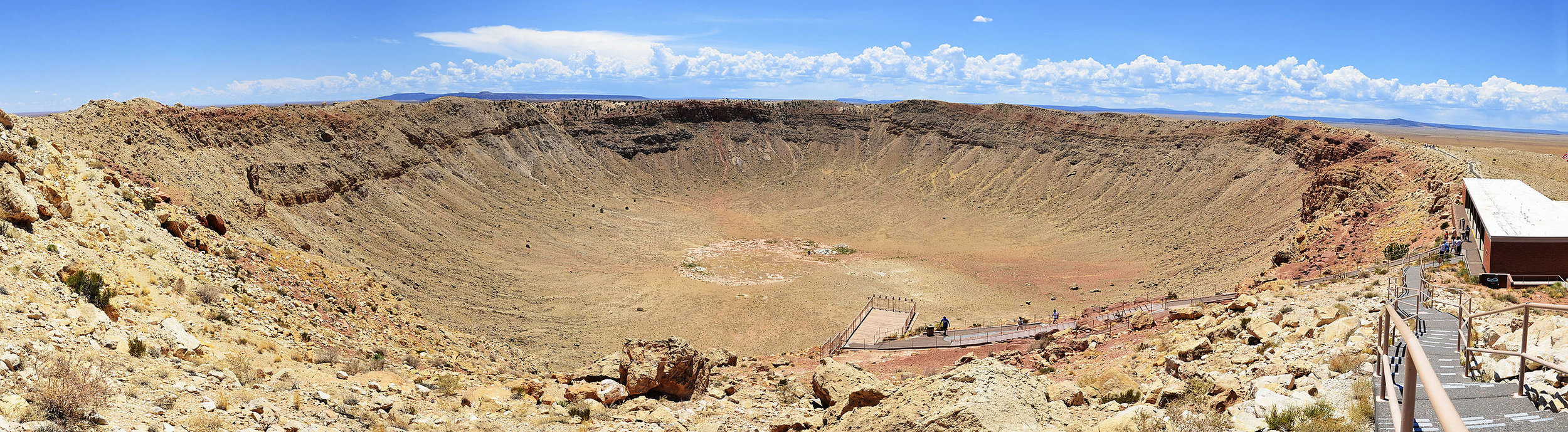 This is a stitched panoramic image of Meteor (or Barringer) Crater located near Winslow, Arizona, 2012 07 11. Image credit: wikimedia user Tsaiproject, CC BY-SA 3.0