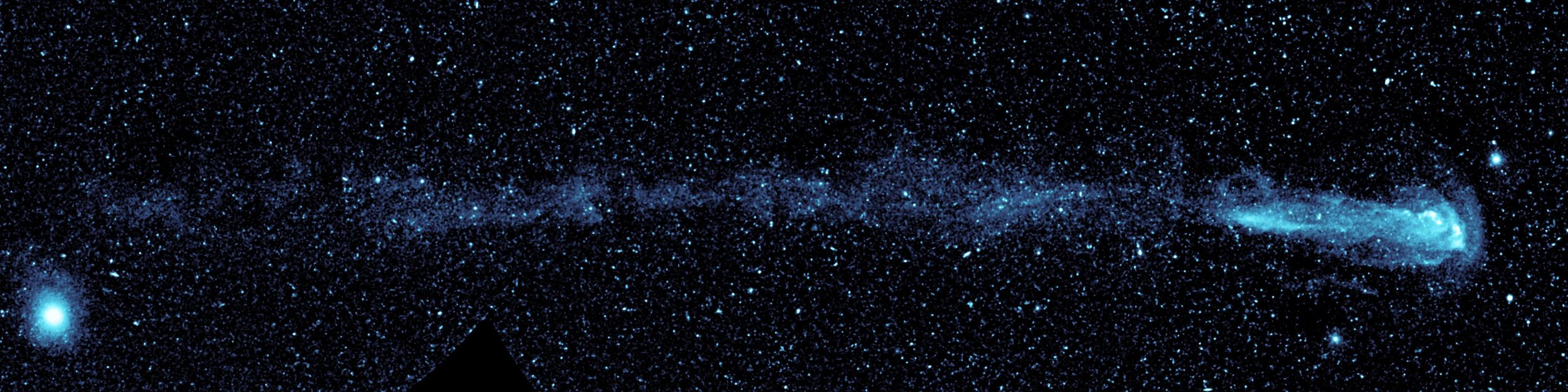 "New ultraviolet images from NASA's Galaxy Evolution Explorer shows a speeding star that is leaving an enormous trail of ""seeds"" for new solar systems. The star, named Mira (pronounced my-rah) after the latin word for ""wonderful,"" is shedding material that will be recycled into new stars, planets and possibly even life as it hurls through our galaxy. Mira, also known as Mira A, is not alone in its travels through space. It has a distant companion star called Mira B that is thought to be the burnt-out, dead core of a star, called a white dwarf. Mira A and B circle around each other slowly, making one orbit about every 500 years. Astronomers believe that Mira B has no effect on Mira's tail. Image credit: NASA/JPL-Caltech"