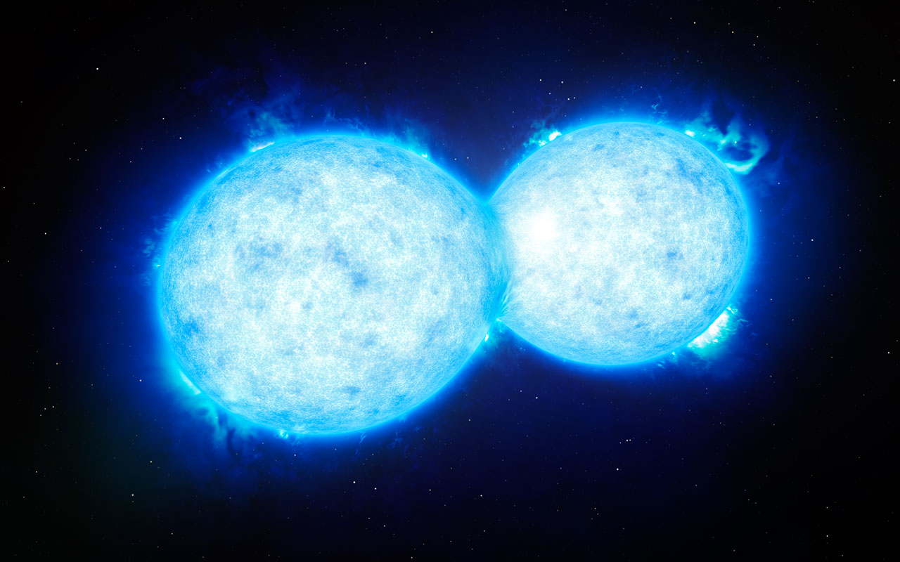 This artist's impression shows VFTS 352 — the hottest and most massive double star system to date where the two components are in contact and sharing material. The two stars in this extreme system lie about 160 000 light-years from Earth in the Large Magellanic Cloud. This intriguing system could be heading for a dramatic end, either with the formation of a single giant star or as a future binary black hole. Image credit: ESO/L. Calçada
