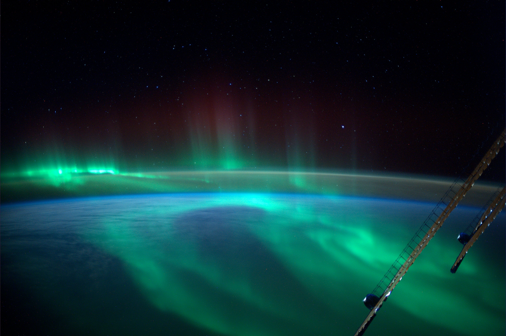 ESA astronaut Alexander Gerst took this image of an aurora as he circled Earth on the International Space Station. Aurora occur when electrons from the Sun hit Earth's atmosphere. Auroras occur frequently over both the North and South polar regions, but are often difficult to see from populated areas. Alexander is a member of the International Space Station Expedition 40/41 crew. He spent five and a half months living and working on the Station for his Blue Dot mission. Image Credit: ESA/NASA
