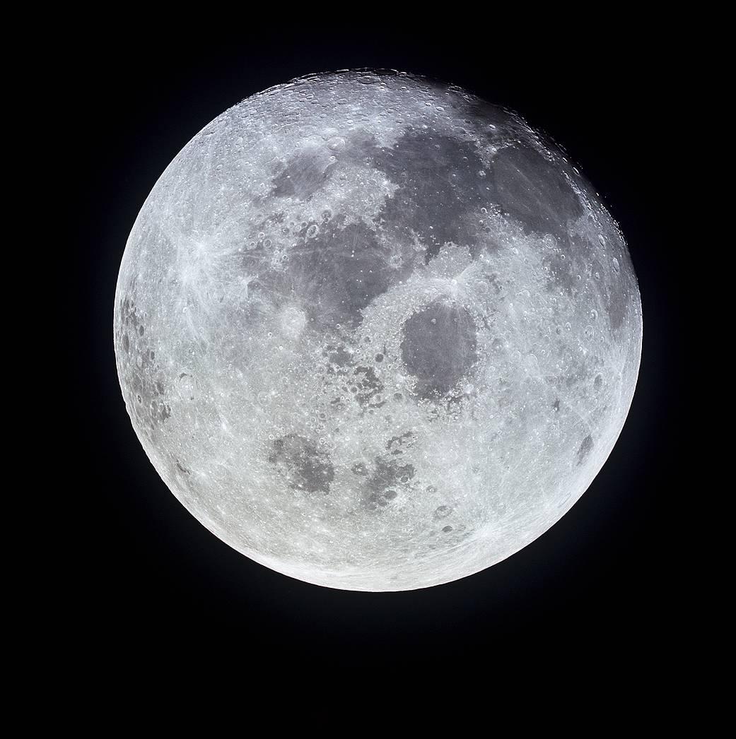 This outstanding view of the full moon was photographed from the Apollo 11 spacecraft during its trans-Earth journey homeward. When this picture was taken, the spacecraft was already 10,000 nautical miles away. On board Apollo 11 were commander Neil Armstrong, command module pilot Michael Collins and lunar module pilot Buzz Aldrin. While astronauts Armstrong and Aldrin descended in the lunar module Eagle to explore the moon, Collins remained on the command and service module Columbia in lunar orbit.Image Credit: NASA