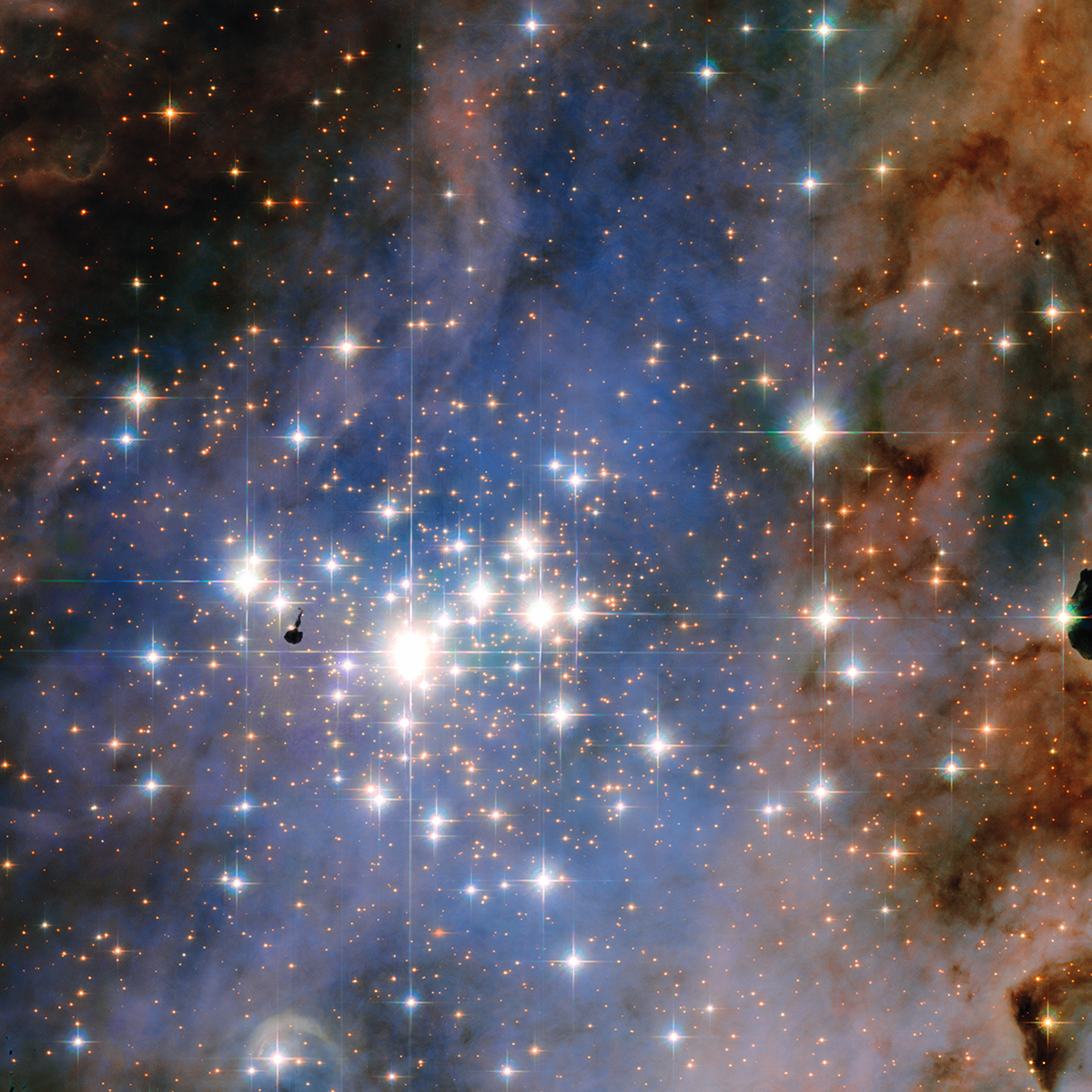 Resembling an opulent diamond tapestry, this image from NASA's Hubble Space Telescope shows a glittering star cluster that contains a collection of some of the brightest stars seen in our Milky Way galaxy. Called Trumpler 14, it is located 8,000 light-years away in the Carina Nebula, a huge star-formation region. Image Credit: NASA, ESA, and J. Maíz Apellániz (Institute of Astrophysics of Andalusia, Spain)