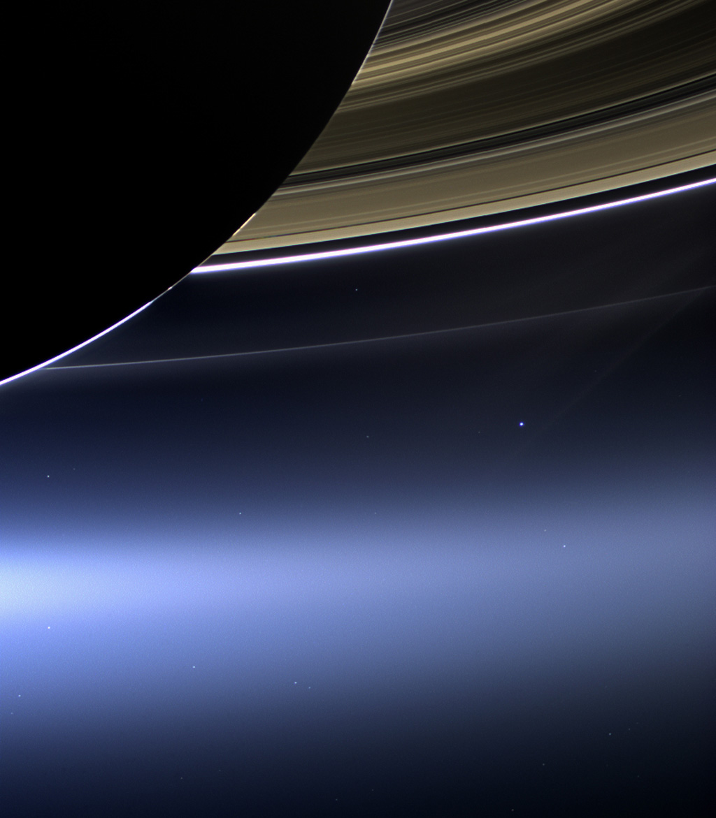 In this rare image taken on July 19, 2013, the wide-angle camera on NASA's Cassini spacecraft has captured Saturn's rings and our planet Earth and its moon in the same frame. It is only one footprint in a mosaic of 33 footprints covering the entire Saturn ring system (including Saturn itself). At each footprint, images were taken in different spectral filters for a total of 323 images: some were taken for scientific purposes and some to produce a natural color mosaic. This is the only wide-angle footprint that has the Earth-moon system in it. Image credit: NASA/JPL-Caltech/Space Science Institute