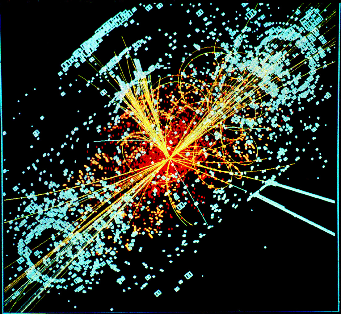 An example of simulated data modeled for the CMS particle detector on the Large Hadron Collider (LHC) at CERN. Here, following a collision of two protons, a Higgs boson is produced which decays into two jets of hadrons and two electrons. The lines represent the possible paths of particles produced by the proton-proton collision in the detector while the energy these particles deposit is shown in blue. Image credit: Lucas Taylor / CERN, CC A-SA 3.0