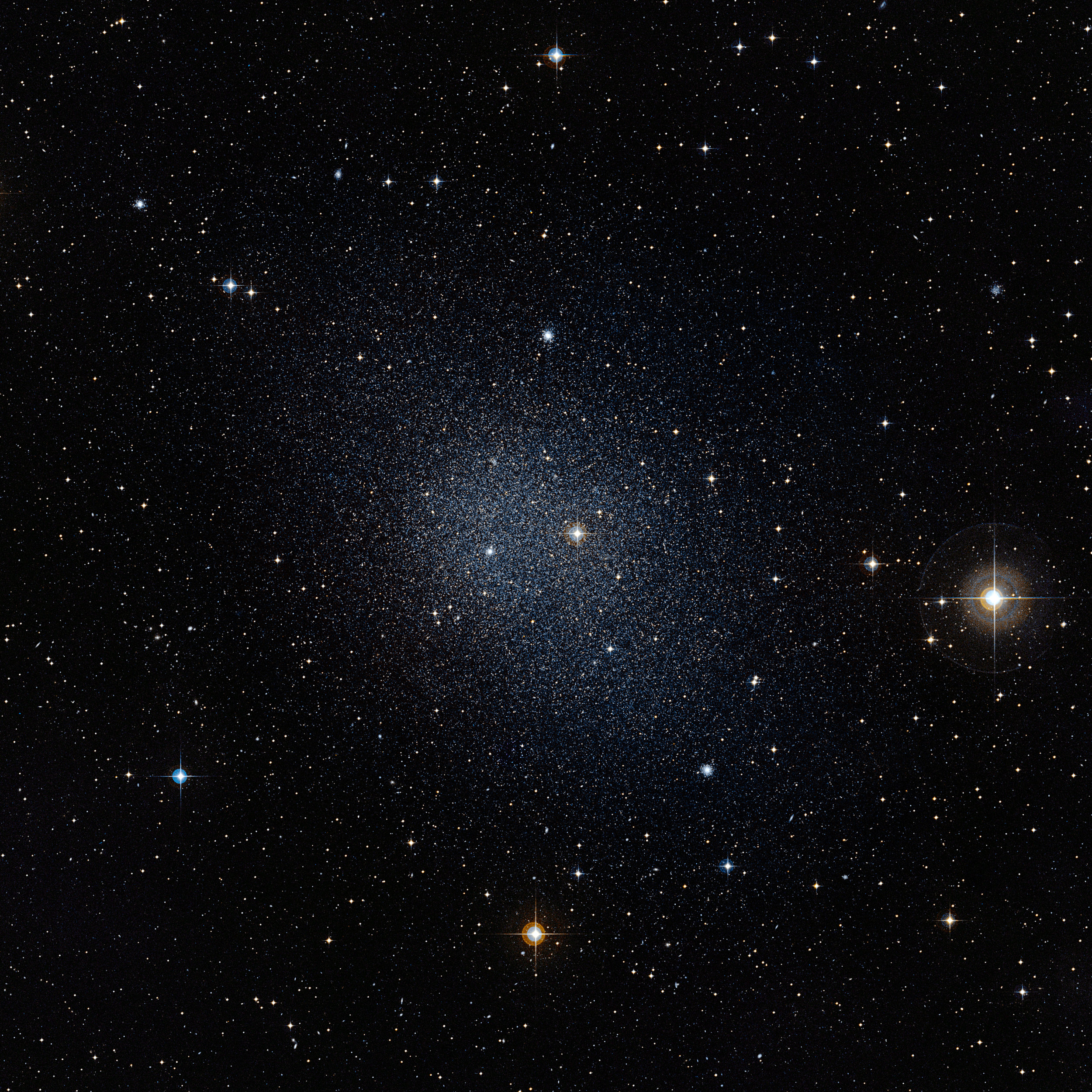 This dwarf spheroidal galaxy in the constellation Fornax is a satellite of our Milky Way and is one of 10 used in Fermi's dark matter search. The motions of the galaxy's stars indicate that it is embedded in a massive halo of matter that cannot be seen. Credits: ESO/Digital Sky Survey 2