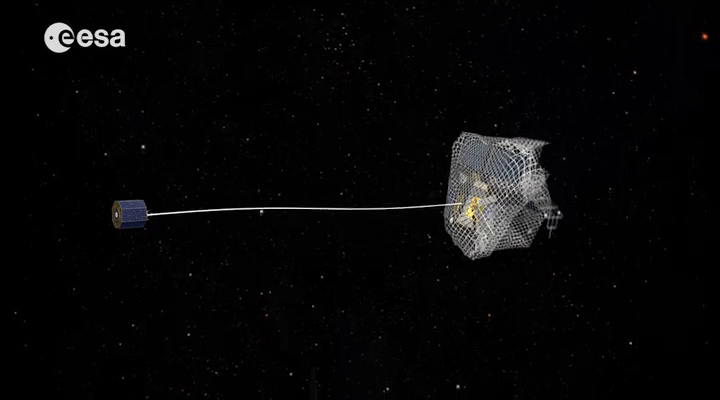One capture concept being explored through ESA's e.Deorbit system study for Active Debris Removal - capturing the satellite in a net attached to either a flexible tether (as seen here) or a rigid connection. Image credit: ESA