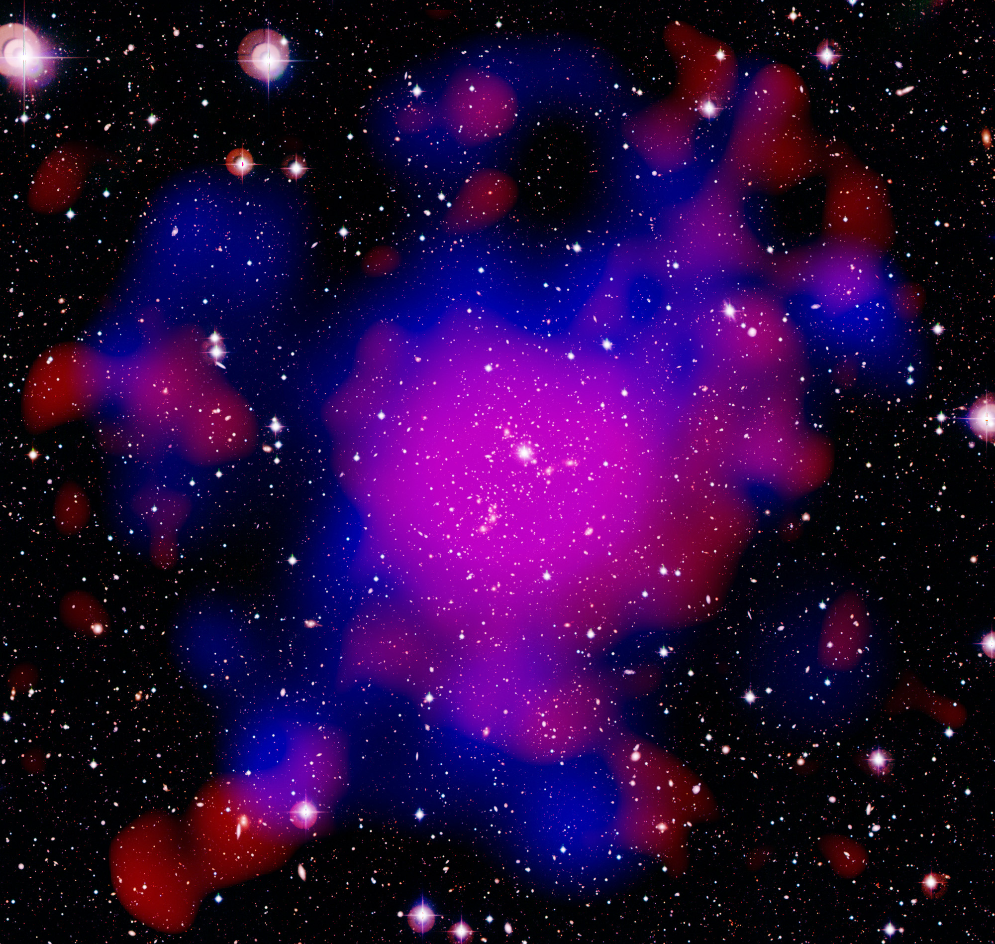 Components of the galaxy cluster Abell 2744, also known as the Pandora Cluster: galaxies (white), hot gas (red) and dark matter (blue). The image measures about half a degree across. The image is sprinkled with foreground stars belonging to our Galaxy, the Milky Way, which are visible as the roundish objects with diffraction spikes. Image credit: ESA/XMM-Newton (X-rays); ESO/WFI (optical); NASA/ESA & CFHT (dark matter)