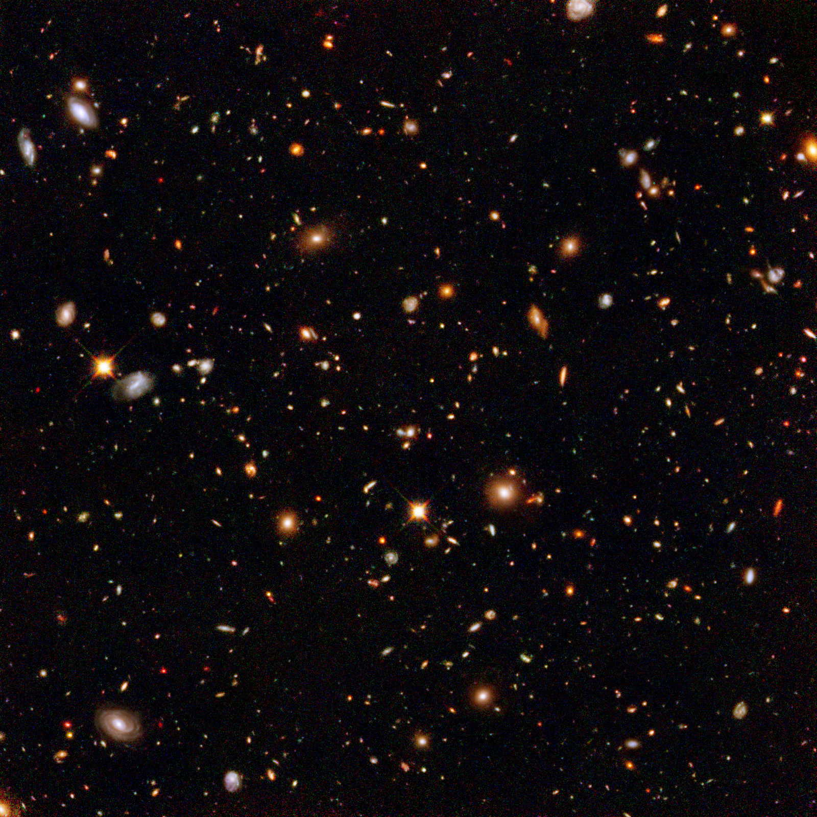 This infrared view reveals galaxies far, far away that existed long, long ago. Taken by the Near Infrared Camera and Multi-Object Spectrometer aboard the NASA/ESA Hubble Space Telescope, the image is part of the Hubble Ultra Deep Field survey, the deepest portrait ever taken of the universe. Image credit: NASA , ESA and R. Thompson (Univ. Arizona)