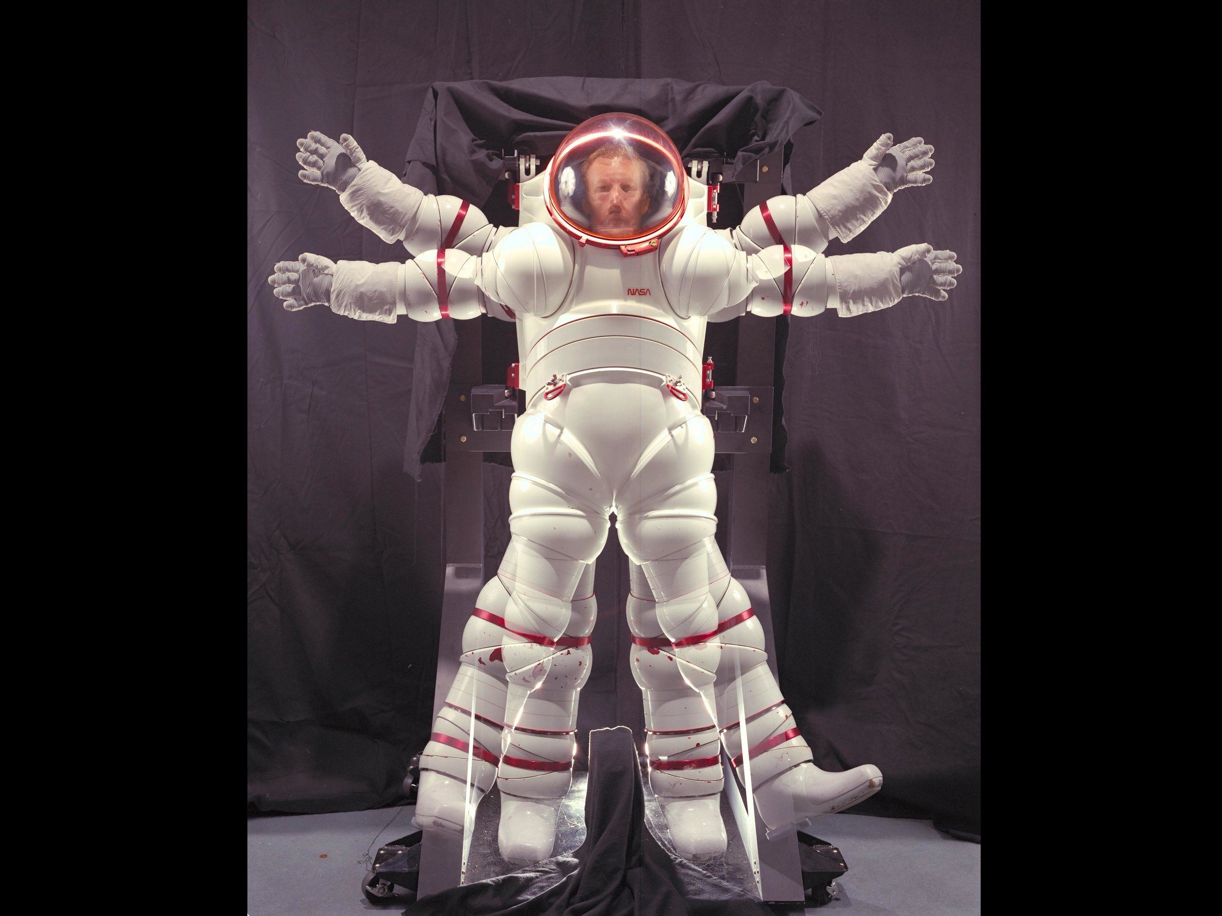 Developed at NASA Ames Research Center in the 1980s, the AX-5 high pressure, zero prebreathe hard suit was developed. It achieved mobility through a constant volume, using a hard metal / composite rigid exoskeleton design. Image credit: NASA