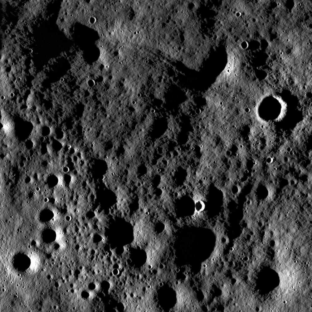 Rugged highland terrain on the farside of the Moon, south of Cantor crater, taken at sunset. Image width is ~3.4 kilometers. Although the pronounced shadows hide the interiors of craters, the high incidence angle exaggerates the surrounding terrain so that subtle surface features are enhanced. Image credit: NASA/GSFC/Arizona State University