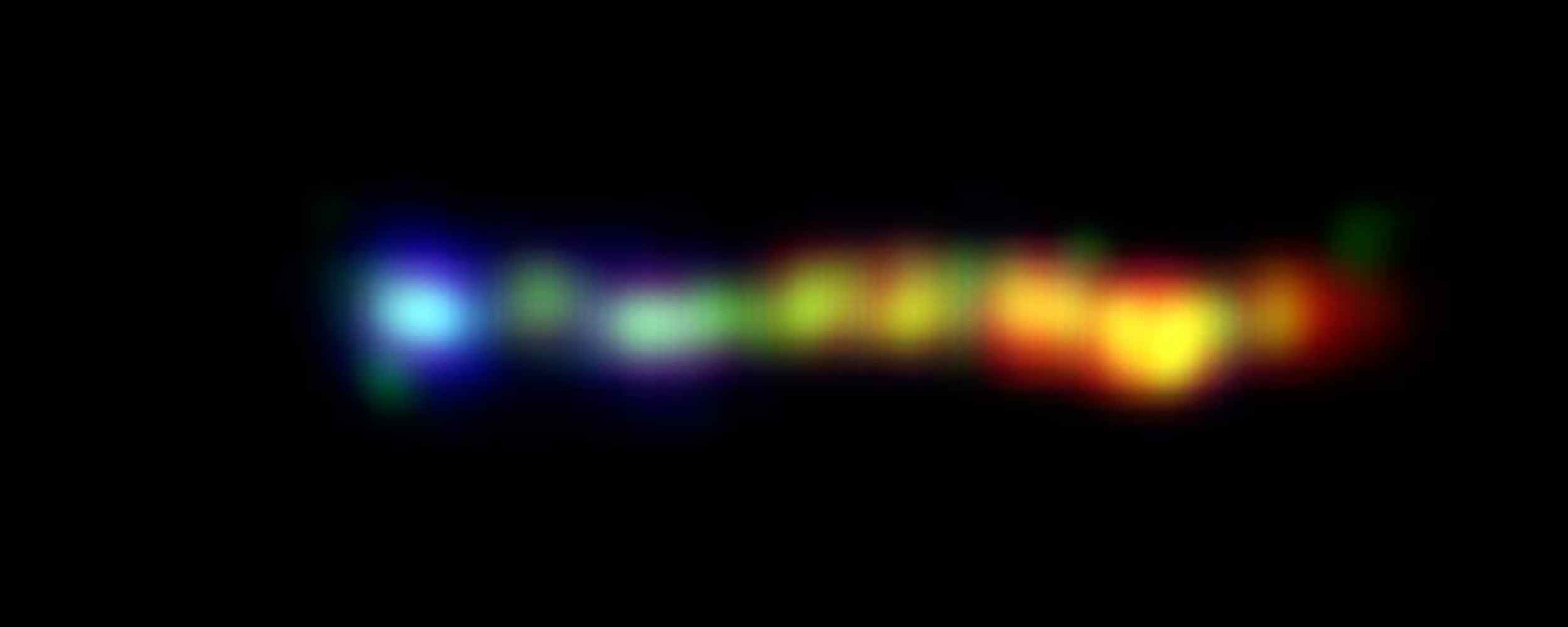 This new false-colored image from NASA's Hubble, Chandra and Spitzer space telescopes shows a giant jet of particles that has been shot out from the vicinity of a type of supermassive black hole called a quasar. Different wavelengths of light are reflected in the different colors. Image credit: NASA/JPL-Caltech/Yale Univ.