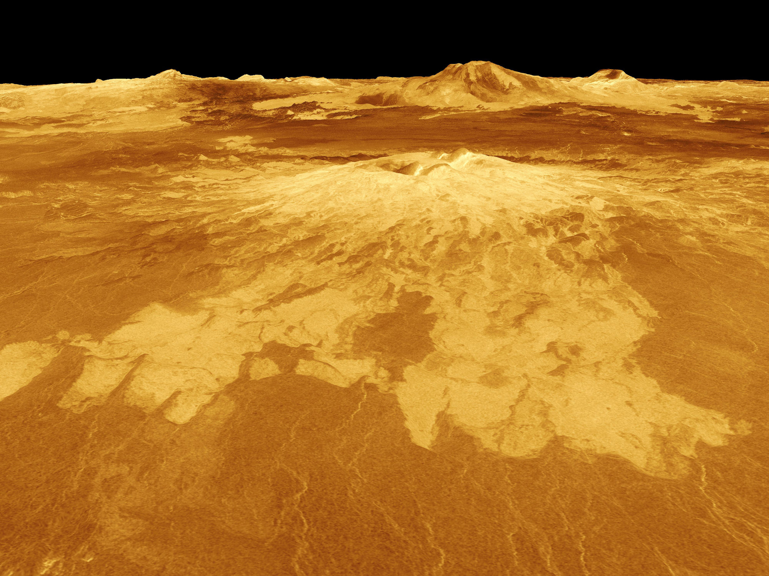 A volcano named Sapas Mons dominates this computer-generated view of the surface of Venus. Lava flows extend for hundreds of kilometers across the fractured plains shown in the foreground to the base of the mountain, which measures 248 miles across by 0.9 miles high. The image was produced by the Solar System Visualization project and the Magellan Science team at the JPL Multimission Image Processing Laboratory. Image credit: NASA/JPL