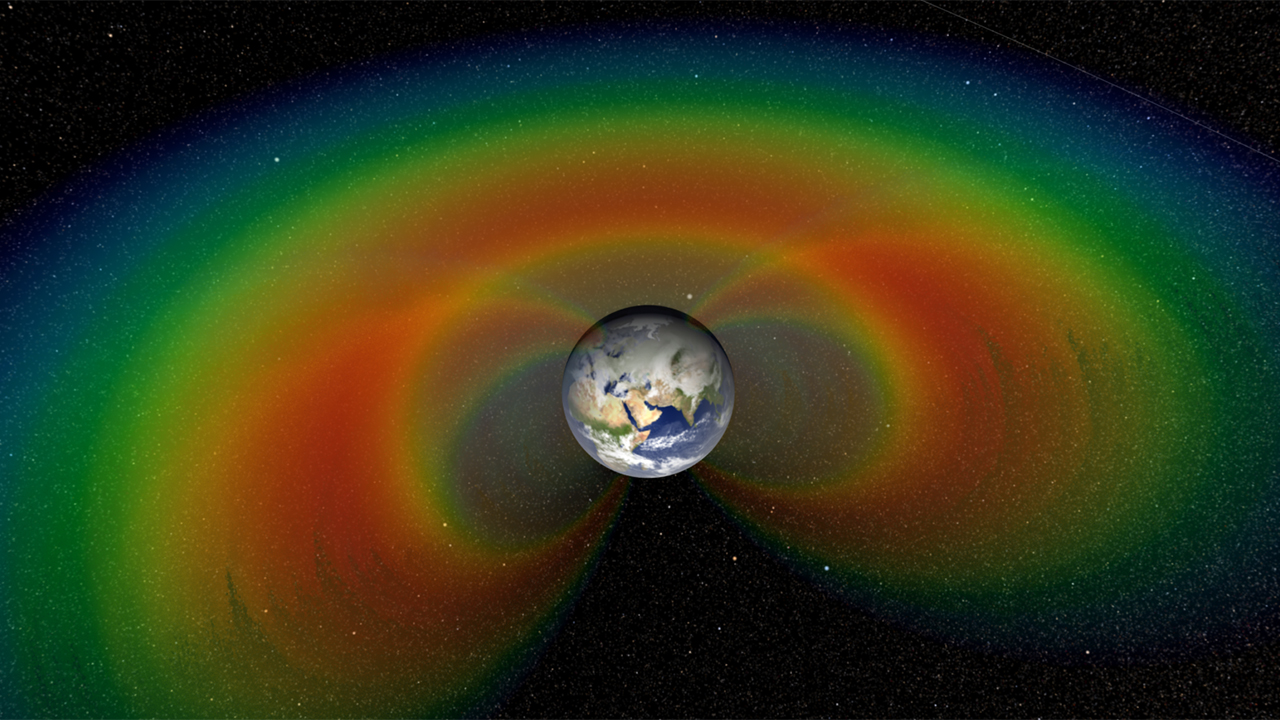 An artist's depiction with cutaway section of the two giant donuts of radiation, called the Van Allen Belts, that surround Earth. Image credit:NASA/Goddard Space Flight Center/Scientific Visualization Studio