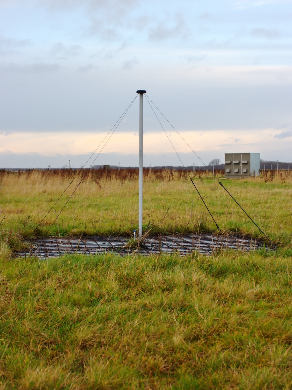 Photo showing a low-band antenna (LBA) of the Low-Frequency Array (LOFAR), an interferometric radio telescope build in Europe. In the right back of the antenna, a LOFAR cabin is visible that contains electronics. The full array consists of thousands of such antennas. Image credit: A. R. Offringa, CC BY-SA 3.0, via  Wikimedia Commons