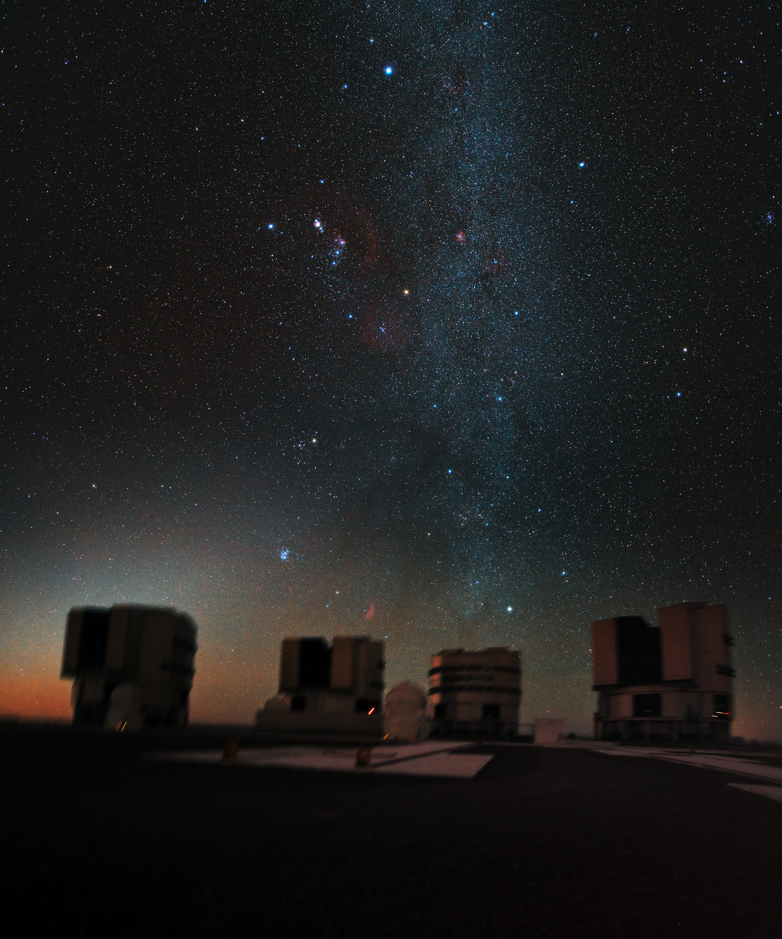The great hunter Orion hangs above ESO's Very Large Telescope (VLT), in this stunning, previously unseen, image. As the VLT is in the Southern Hemisphere, Orion is seen here head down, as if plunging towards the Chilean Atacama Desert.  Image credit : ESO/ Y. Beletsky