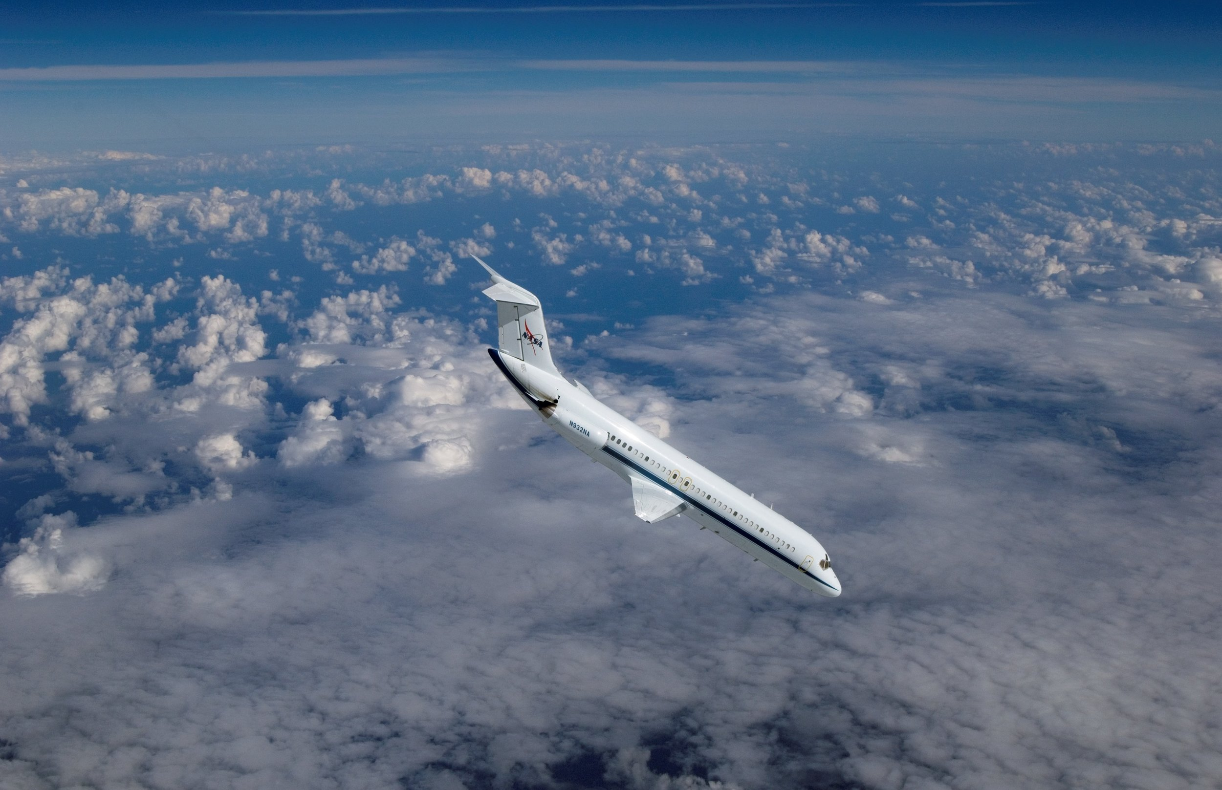 A NASA DC-9 reduced-gravity aircraft is featured in this image during a parabolic flight photographed from a T-38 aircraft. Image credit: NASA