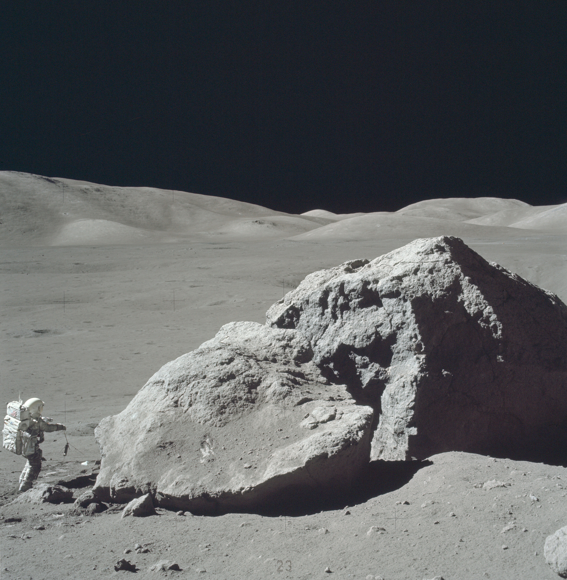 Scientist-Astronaut Harrison H. Schmitt is photographed standing next to a huge, split boulder at Station 6 (base of North Massif) during the third Apollo 17 extravehicular activity (EVA-3) at the Taurus-Littrow landing site on the Moon. Image credit: NASA