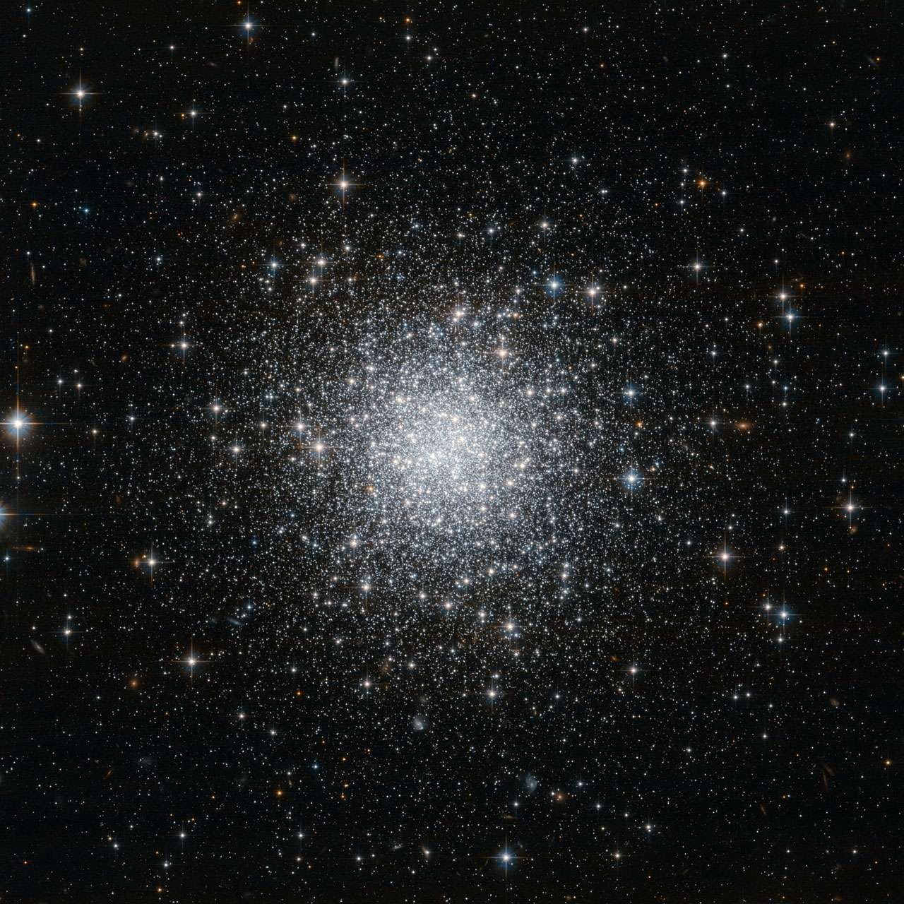 This NASA/ESA Hubble Space Telescope image shows a compact and distant globular star cluster that lies in one of the smallest constellations in the night sky, Delphinus (The Dolphin). Image credit:  ESA/Hubble & NASA