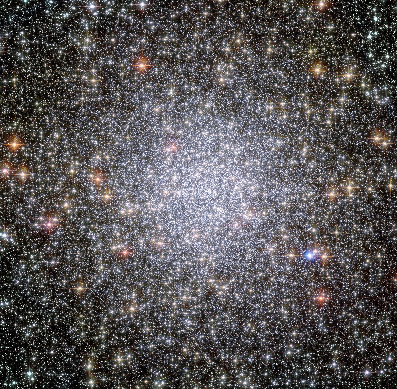 This image shows a globular cluster known as NGC 104 — or, more commonly, 47 Tucanae, since it is part of the constellation of Tucana (The Toucan) in the southern sky. After Omega Centauri it is the brightest globular cluster in the night sky, hosting tens of thousands of stars. Image credit:  ESA/Hubble & NASA