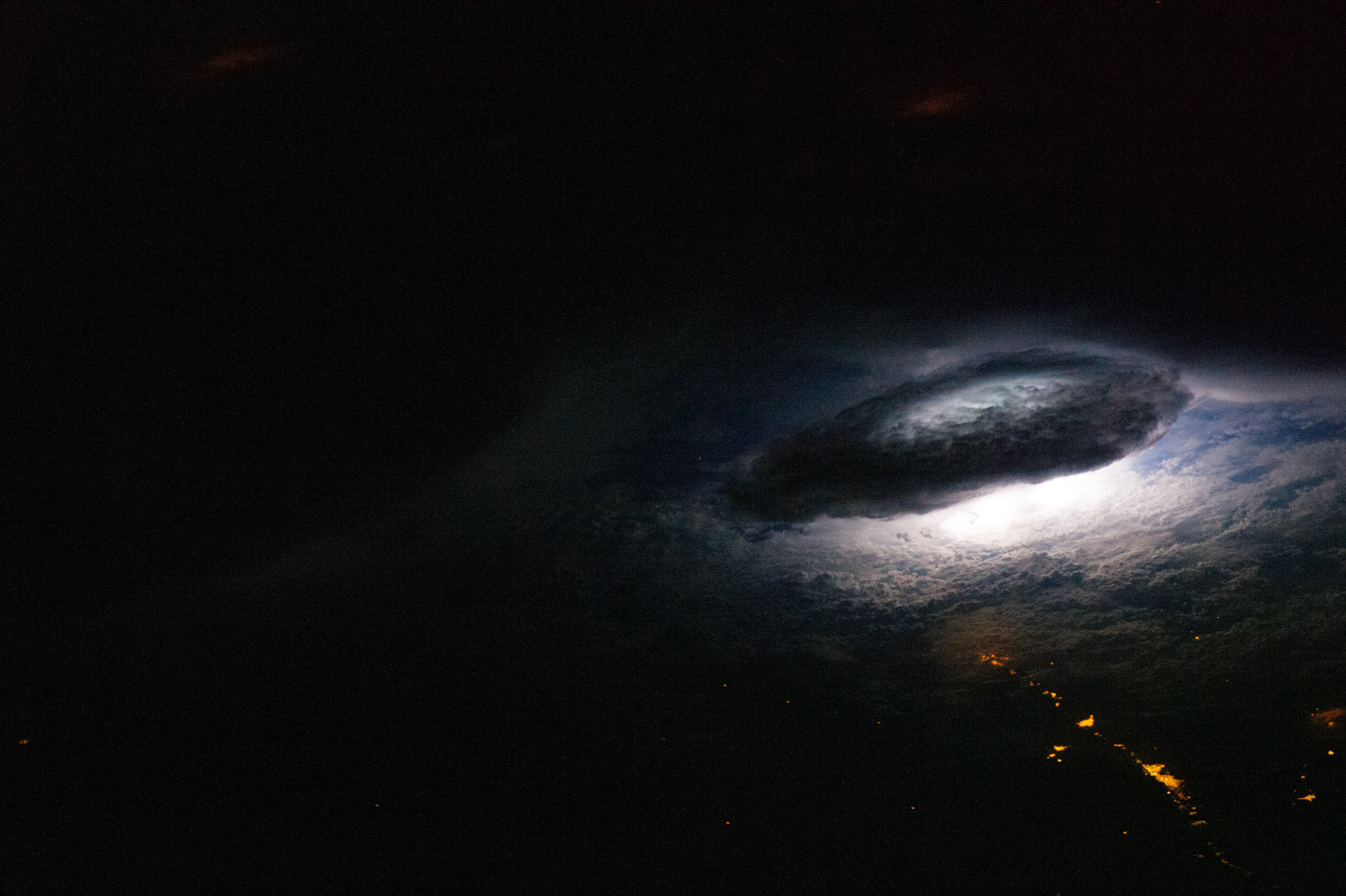 An astronaut orbiting over Bolivia captured a close-up of a lightning flash beneath a thunderhead on January 9, 2011. Image credit:  NASA