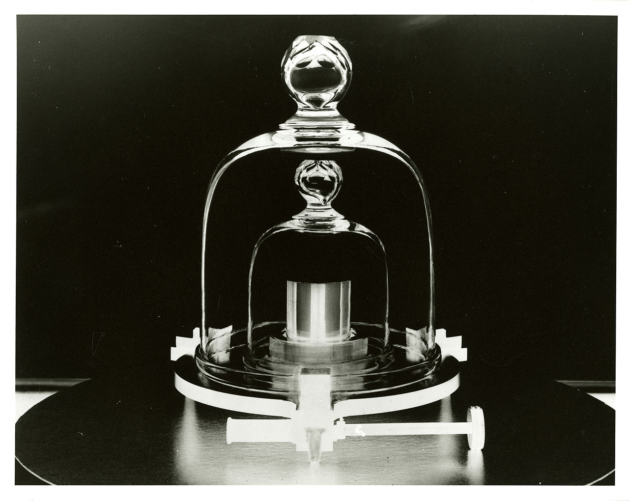 Bell jar display of prototype kilogram replica,  public domain via National Institute of Standards and Technology