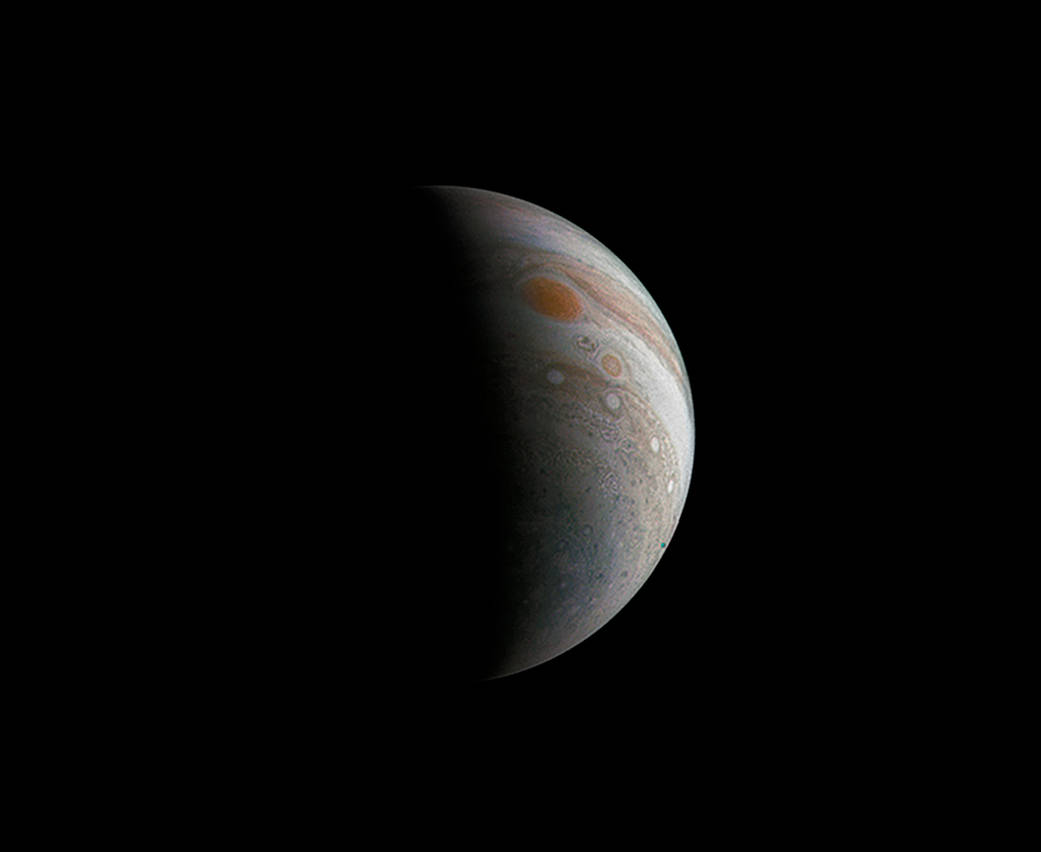 This image of a crescent Jupiter and the iconic Great Red Spot was  created by a citizen scientist (Roman Tkachenko) using data from Juno's JunoCam instrument.    Image credit: NASA/JPL-Caltech/SwRI/MSSS/Roman Tkachenko
