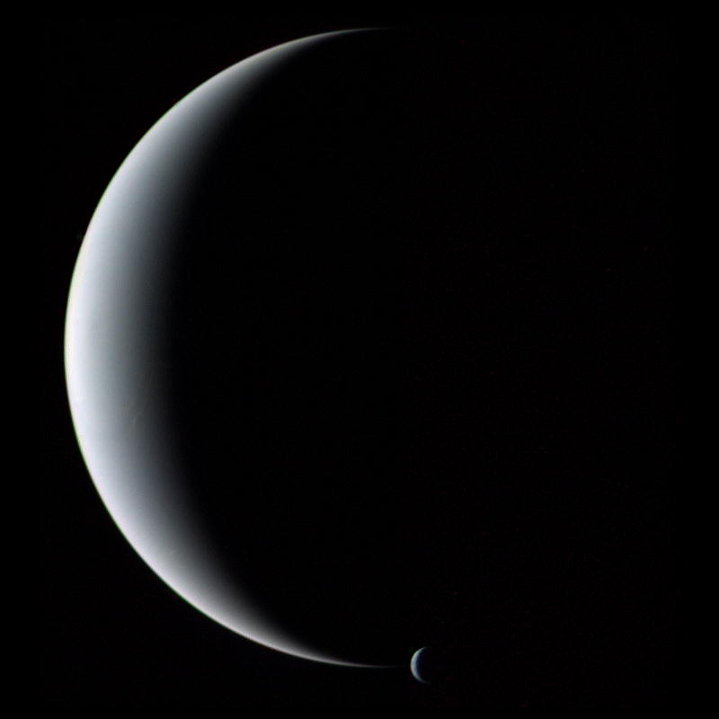 Crescent Neptune and Triton.    Image credit: Voyager 2, NASA