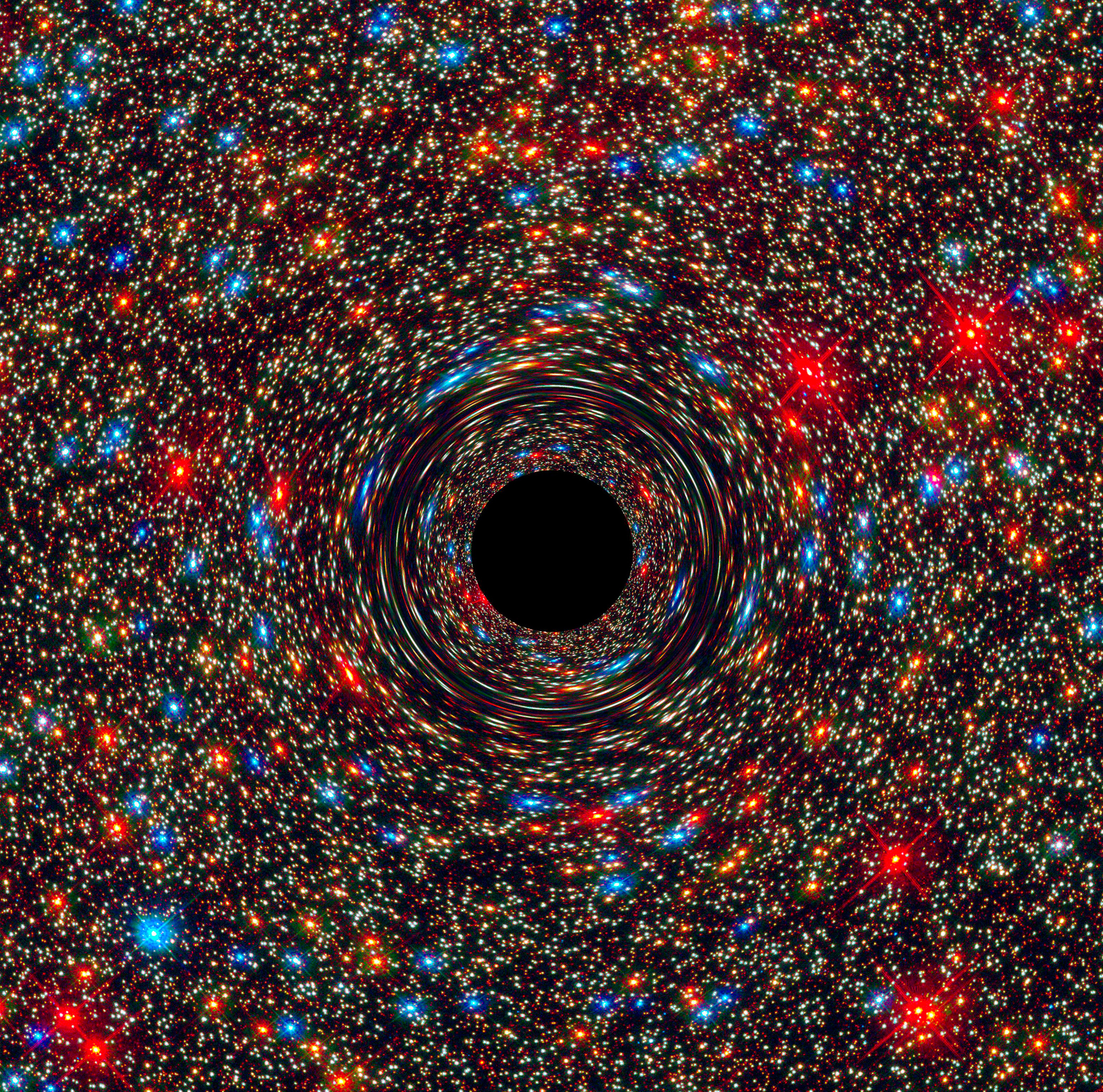 This computer-simulated image shows a supermassive black hole at the core of a galaxy. The black region in the center represents the black hole's event horizon, where no light can escape the massive object's gravitational grip. Image credit:    NASA, ESA, and D. Coe, J. Anderson, and R. van der Marel (STScI)